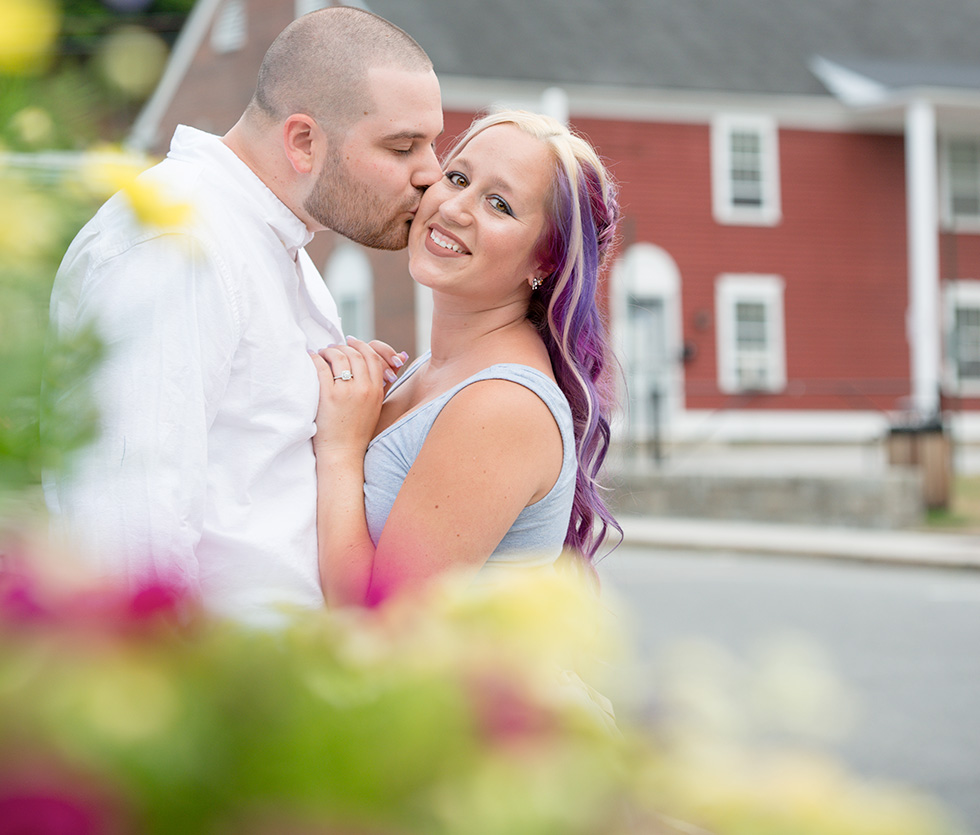 kissing engagement photo