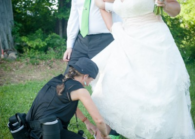 Lindsey putting a brides shoes on